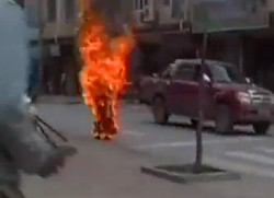 tibet nun on fire